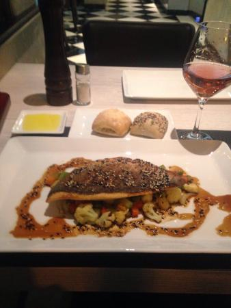 Mediterraneo 1930: Sea bream on a bed of teppanyaki vegetables/ginger sauce. Toledo oil for bread dipping. Exquisit
