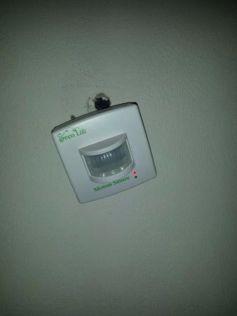 Quality Inn East Windsor: creepy motion detector hanging out of the wall