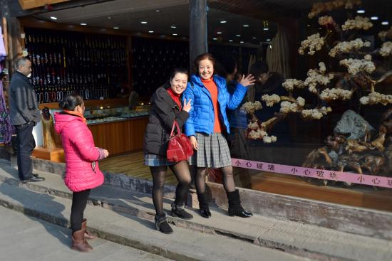 Wenchuan County, China: Friends pose for this one in front of shop.......