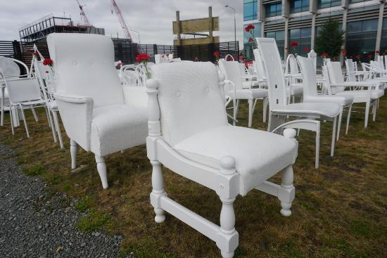 View Picture Of 185 Empty White Chairs Earthquake