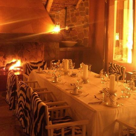 Dinner by the fireplace on the terrace... one of the many dining areas