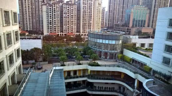 Shunde Jiaxin Conifer Garden Hotel: View from room on 8th floor showing high density surrounding buildings.