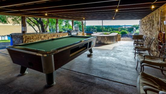 outdoor pavilion with billiard table and 55 inch outdoor tv to watch