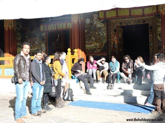 Bomdila, Индия: Our guide Sange, Describing about the Tawang Monastery to the clients from Germany.