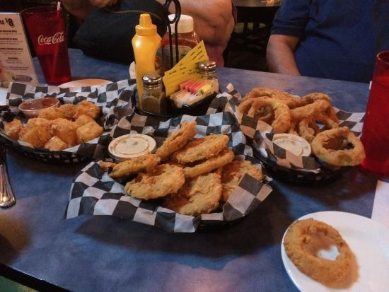Woody's Roadside: Three appetizers. From left, mozzarella cubes, fried green tomatoes, onion rings.
