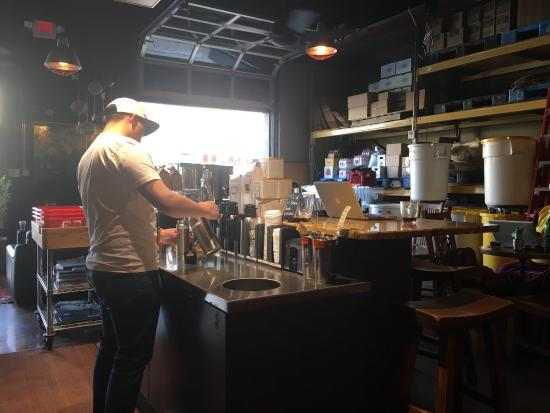 Rojo's Roastery: Roomy, industrial rustic decor. Storage feel all the way. Great coffee.