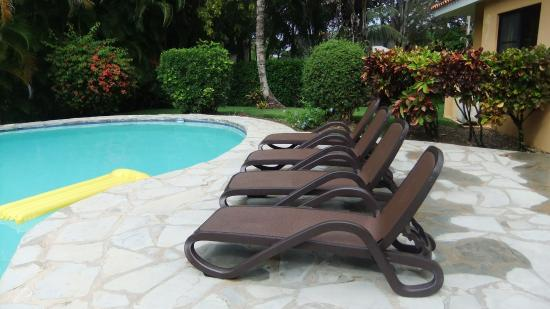 pool deck between outdoor dining area and pool with brand new lounge rh tripadvisor com