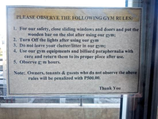 Rules fines sign posted in fitness room. picture of shaw residenza