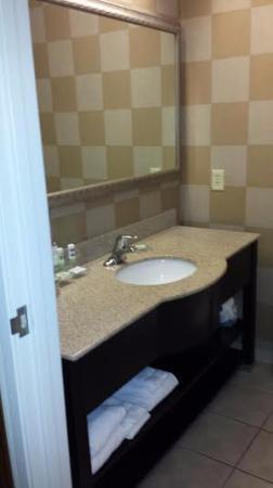 Country Inn & Suites by Radisson, Athens, GA: Sink/dresser w/towels & supplies underneath