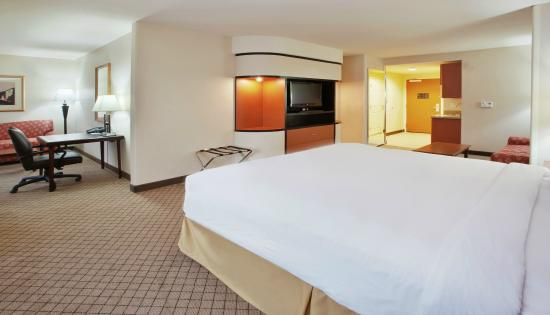 Holiday Inn Express Hotel & Suites Lincoln: One King Bed Suite with a Sofa Bed and Office area with a Desk