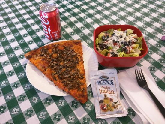 Giovanni's Pizza: Mushroom slice and small salad. Everything was very clean.