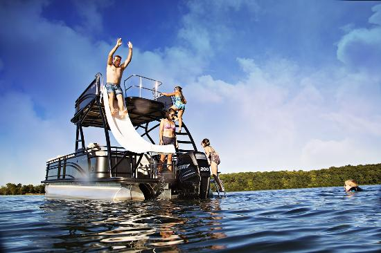 Pontoon boat with slide - Picture of Runamuk Rides, Hayward