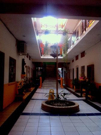 Hotel Villa Del Mar: Open central stairway - windows face toward this
