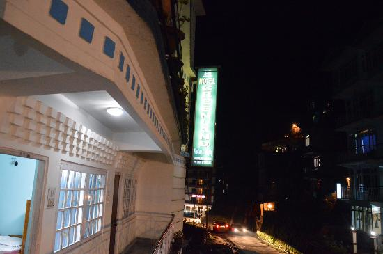 Greenland Hotel: Th illuminated sign of the hotel as seen from the balcony.