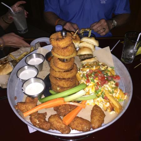 Champions Sports Bar: Sampler Platter- Wings, onion rings, slider sandwiches, and fries with toppings!