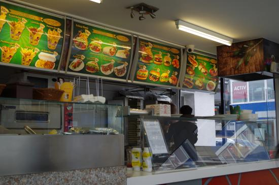 Menu display above the service counter bild von ali baba for Top haus countertops