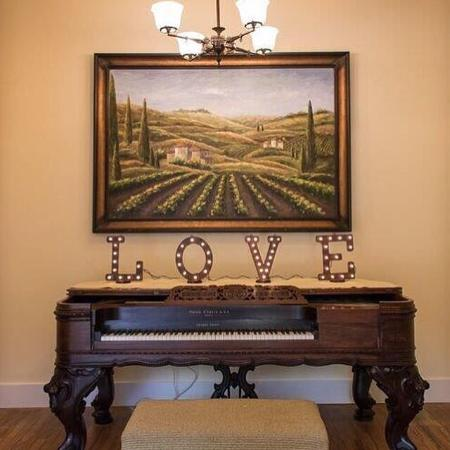 Inviting, luxurious rooms, romantic parlor and stunning 1880 Square Grand piano are hallmarks of