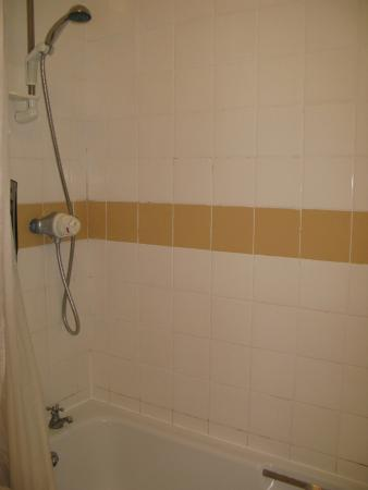Stand up shower in bath..... powerful jet though!! - Picture of ...