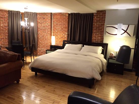 large room with bed dining table in far corner sofa and chair rh tripadvisor co uk