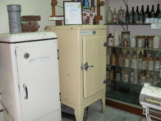 Meningie, Australia: old fridges (ice boxes) and assorted bottles from the past