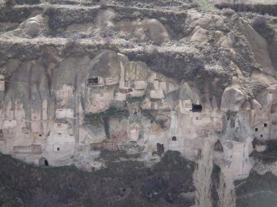 Cave dwellings and pigeon houses in the rock faces of ...