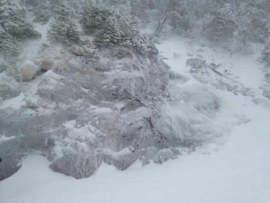Jay Peak Resort: Ice along a rock wall up high.