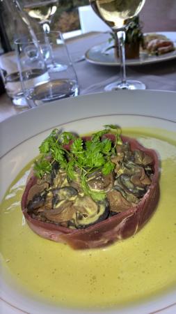 Saint-Ouen-Les-Vignes, Frankrig: escargots au lard