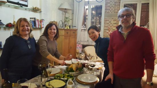 Carmelites Guesthouse: Christmas Eve dinner. My daughter and I on the left. Pascal and Akemi on the right.