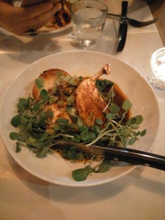 Main dish of roast chicken, adobo sauce, potato, kale and green tomato salsa