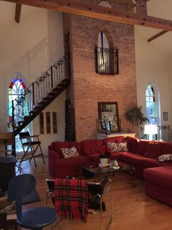 """Manilla, Canada: Main sitting area with fireplace (and """"princess tower"""" room at the top of the stairs)"""