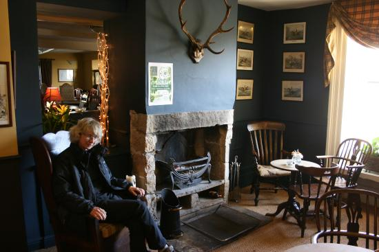 "Bashall Eaves, UK: ""Snug"" pre-dining area next to log fire."