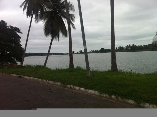 Yamoussoukro, Ivory Coast: View of the Presidential palace and surrounding lakes. Cathedral on the right