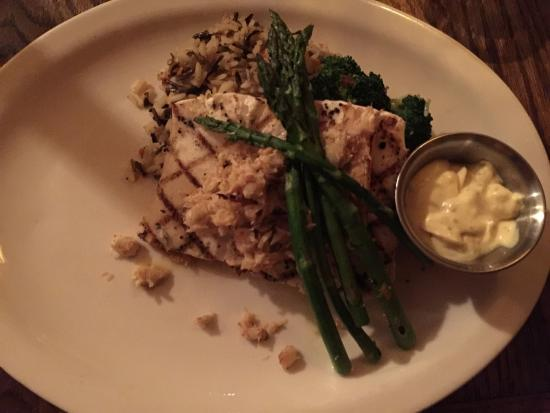 Blue Spruce Inn : Grilled halibut & crabmeat (special) with wild rice, asparagus,and broccoli with sauce on the si
