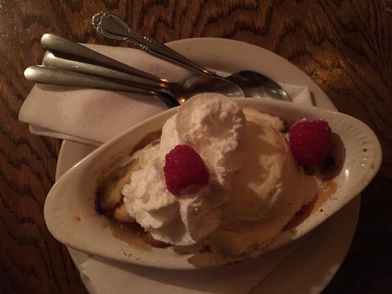 Blue Spruce Inn : Apple cobbler with vanilla ice cream raspberries and whipped cream