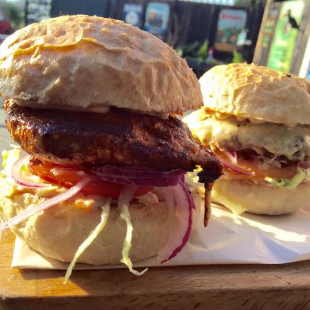 Exhall, UK: Spiced chicken burger and JP's cheeseburger