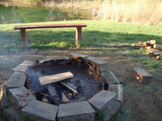 Rogers, KY: Fire pit with benches, we moved a couple of brick pieces so we could sit closer.