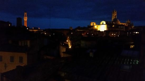 I Tetti di Siena: View of City from Balcony at Night