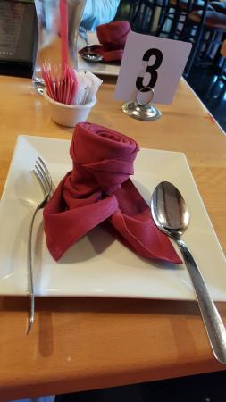 Irving, TX: Place setting ~ a charming, maroon rose cloth dinner napkin