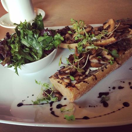 Le Perche: Wild Mushroom Tartine with melted brie and balsamic on toasted whole wheat baguette