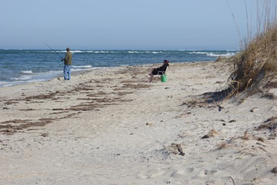 Ocracoke Island Visitor Center: A woman watching her man enjoy his past-time.
