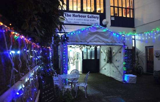 St Aubin, UK: The Harbour Gallery Front Entrace Lit up at Night