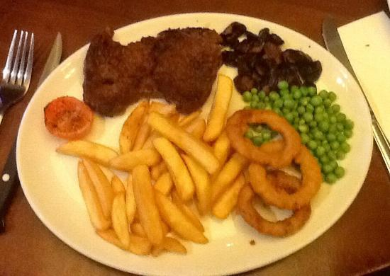 Greasby, UK: 8oz Rump Steak with chips, peas, onion rings and half tomato.