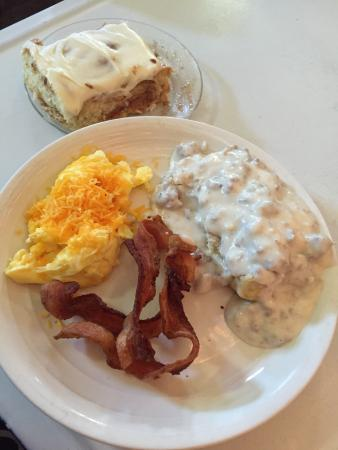 Biscuits and sausage gravy, eggs, bacon, and cinnamon roll