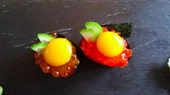 Salmon roe with quail egg and flying fish roe with quail egg sushi ...
