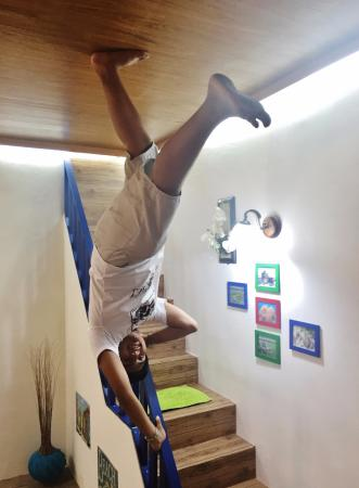 upside down world stairs acrobat