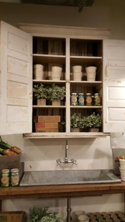 Whimsical kitchen metal sink display with flower pots herbs and magnolia market at the silos whimsical kitchen metal sink display with flower pots herbs sisterspd