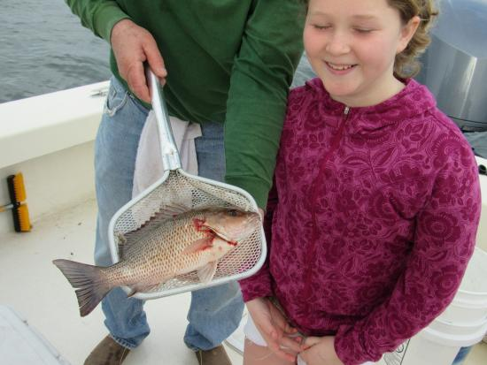 Captain Van Hubbard Fishing Charters: Evelyn with the first fish of the day. Red snapper.