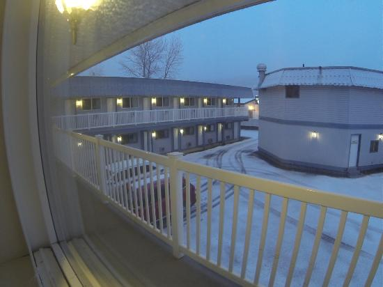Canyon Motor Inn: View from room at dusk as the snow started to fall.