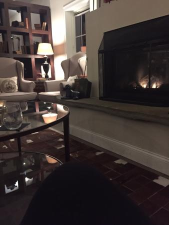 Fireplace in restaurant area with large comfortable couch
