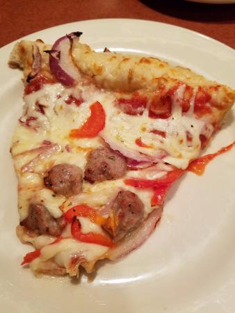 Old Chicago: Ale Crust Pizza with Sausage, Red Onions, and Red Peppers.
